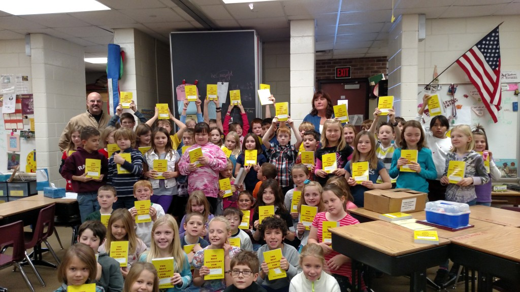 Exalted Ruler Ken Rogers and Elks member Margie Tamminga presented dictionaries to local third grade students.